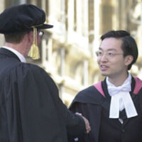 photo of a couple of graduates standing outside Senate House in Cambridge